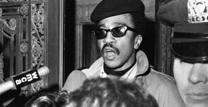 "H. Rap Brown, then 24 and head of SNCC, speaks to the media from the Cuban U.N. mission, where he took refuge for nearly six hours after a scuffle with police as he and an aide left after a meeting and were invited back in for protection. AP reports that Rap told the press: ""'It is an action to crush dissent,' he charged. 'We came in as guests and we serve notice again that if white people are going to play Nazis, Black folks ain't goin' to play Jews.'"""