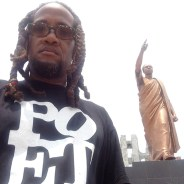 "Hodari Davis stands in front of ""African Independence,"" the world famous statue of Kwame Nkrumah in Ghana."