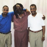 In a picture taken last year, Mumia stands between his son, Jamal Hart, and his older brother, Keith Cook.