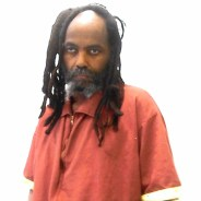 Mumia, no glasses, barely able to stand Mahanoy infirmary 040615, cropped