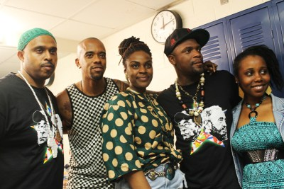 At the heart of the June 2014 concert for the Cuban 5 in Washington, D.C., were Obi Egbuna, Stic Man, Mistress of Ceremonies Chioma Iwuoha, M1 and a background singer with Roots Radics. – Photo: Amoa Salaam