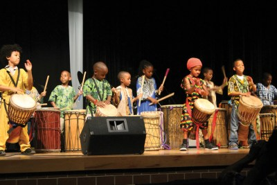 Farafina Kan's Denu drummers and dancers, ages 3-7, opened the concert. Small but so full of energy these little performers make thunder and lightning on stage. – Photo: Amoa Salaam