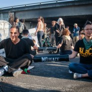 Protesters – chained together – blocked the intersection of Lakeshore and Lake Park for two hours Friday evening. – Photo: Brooke Anderson