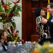 Jamaica Prime Minister Portia Simpson Miller and British Prime Minister David Cameron embrace at the conclusion of their bilateral talks at Jamaica House on Oct. 9. – Photo: PA