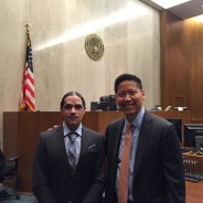In the federal courtroom where his case had just been heard in a two-week trial, Jesse Perez and lead attorney Randall Lee reflect on their victory. – Photo: Katie Moran