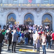 Supporters of justice for Mario Woods, executed firing squad-style by SFPD on Dec. 2, braved unusually cold weather on Christmas Eve to rally on the steps of City Hall. They marched in and up to Room 200, the mayor's office, to see him, but aides said he wasn't there. – Photo: Majeid Crawford