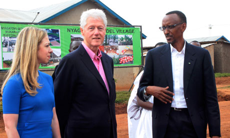 Bill Clinton and his daughter Chelsea are led by Paul Kagame on a tour of Rwanda health clinics in July 2012. – Photo: Cyril Ndegeya, AP
