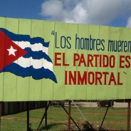 "This billboard in Havana reads, ""Men die; the Party is inmortal."""