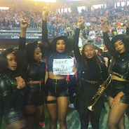 "Some of Beyoncé's dancers took a moment to pose with a ""Justice 4 Mario Woods"" sign, living the role of the Black Panthers that their costumes portray. – Photo: Kofi Ademola Xola"