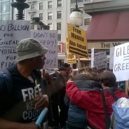 "Gilead, the profiteer pricing its Hep C cure far too high for 3 million sufferers, including 700,000 prisoners in the U.S. to use it, participated in a ""health conference"" sponsored by JP Morgan at the St. Francis Hotel in San Francisco. The big boys from Big Pharma were greeted by a crowd of mostly retired workers protesting their unconscionable greed. – This and all the protest photos: Anka Karewicz"