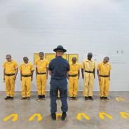 A guard humiliates juvenile prisoners.