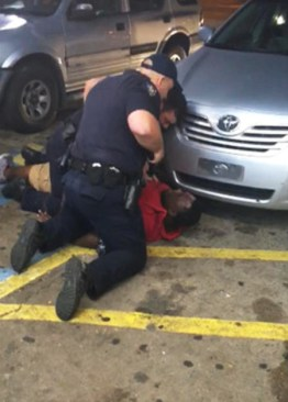 Police who hassled Alton Sterling for selling CDs outside a store are caught executing him in a video by the store owner, who had given him permission to sell his CDs. – Screenshot: Abdullah Muflahi