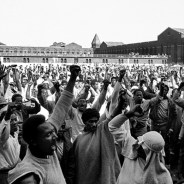 Attica prisoners shout demands during a negotiating session with state corrections officials. – Photo: AP