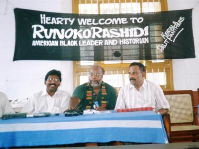 On Runoko Rashidi's second visit to India, in April 1998, he was welcomed royally in Trivandrum, the capital of Kerala, India, by the Kerala Dalit Panthers, whose leader, a great man named K. Ambu Jakshan, is seated at the left. The poem is a tribute to him. Rashidi is in the center, and on the right is Raju Thomas. The Dalits are also known as the Black Untouchables of India.