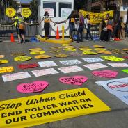 Protesters who had chained themselves together managed to hold on and keep the main entrance to the Alameda County Fairgrounds closed as 23 of the group of more than 500 were arrested. – Photo: Stop Urban Shield