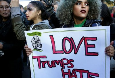 Demonstrators march in protest of President-elect Donald Trump's anti-immigrant rhetoric outside the Trump International Hotel and Tower at Columbus Circle in Manhattan, Nov. 13, 2016. – Photo: Yana Paskova, New York Ttimes