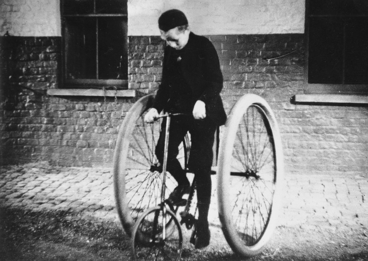 IRELAND - 1888: John Boyd Dunlop (b. February 5, 1840 - d. October 23, 1921), a Scottish inventor, re-built the tires of a tricycle in 1887 for his 10-year-old son (pictured). The invention included a tire tube made of a rubber surrounding an envelope of fabric, which was inflated with an air pump. By 1888, Dunlop patented what was the first practical pneumatic tire which formed the foundation for the Dunlop Tire Company and was the beginning of the modern tire industry. (Photo by Jacques Boyer/Roger Viollet/Getty Images)
