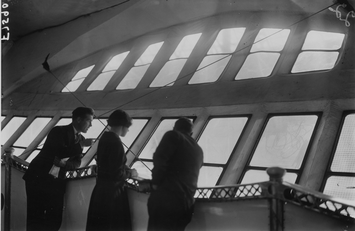 Passengers surveying the scene from the verandah deck of the British R100 Airship, built to compete with the great ocean liners. (Photo by A R Coster/Getty Images)