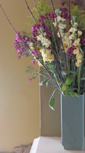 stock and waxflower in vase on mantel