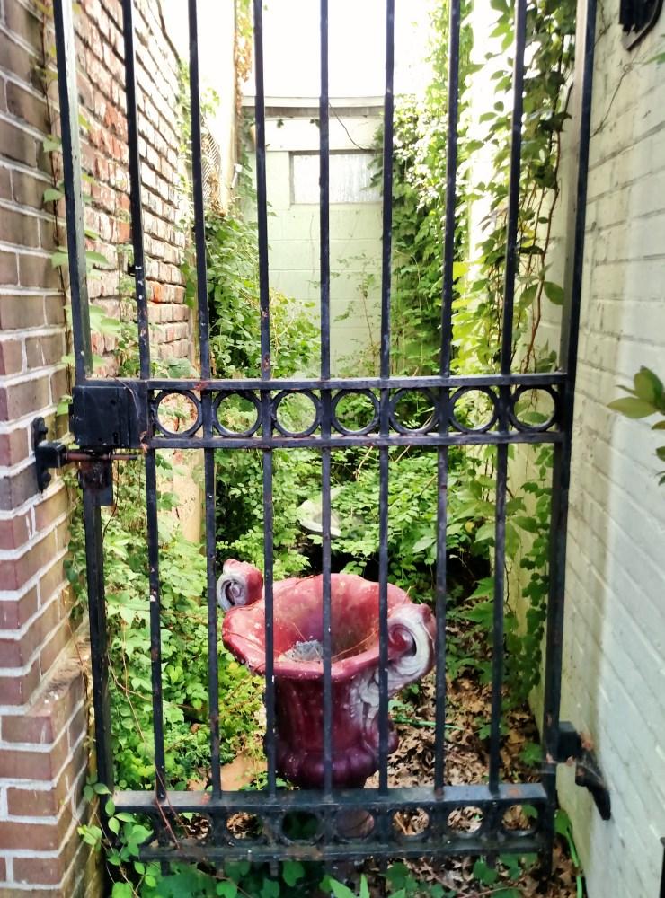 urn behind the fence on Shalavee.com