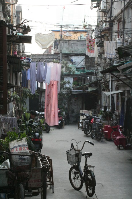 Older parts of Shanghai are slowly getting removed to make room for the new skyscrapers and other developments.  This alleyway was pretty much in between the last two buildings.  A bastion of history against the onslaught of progress...