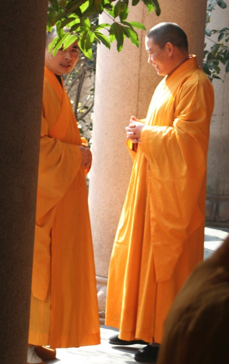 I caught the one monk staring at me in the middle of their conversation.  When I got to the end of the hallway, I noticed they were both admiring a scooter that had been parked there.