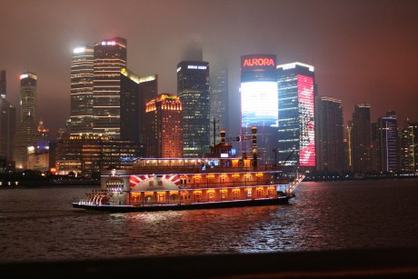 There are boats you can take up and down the river along the Bund/Pudong.  I did ride a ferry across the river one afternoon, but never took one of these electrified rides.  There was also a masted ship that went by on this night, but none of those pictures turned out. :(