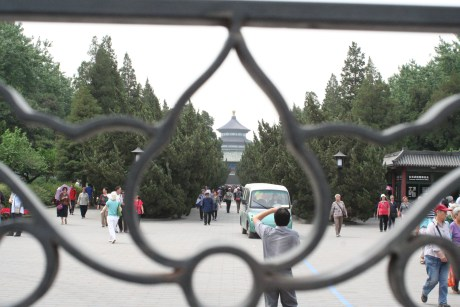 Looking back at the Temple of Heaven through the gate.  Time to catch a cab back to the hotel and load up for Xi'an.  When catching cabs in China, you need to show them the address written in Mandarin so they know where you want to go.  The first cab we flagged down for whatever reason didn't want to take us back to our hotel.  That refusal probably saved us a bit of trauma as when we finally did grab one, we drove by an accident of moped versus vehicle and it didn't turn out so well for the moped driver.