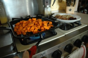 Making Caramelized Butternut Squash Chicken without electricity in on cast iron skillet