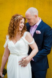 Bride and Groom Portrait - Fun - Yellow Wall - Offbeat Bride - St.Lawrence Market Wedding - Toronto Wedding Photographer
