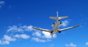 Airplanes-and-Beaches-in-St.-Maarten-Learjet-landing-at-Princess-Juliana-Airport