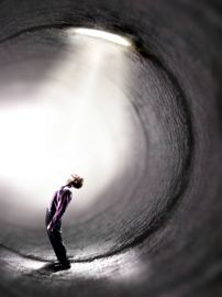 man in tunnel of light