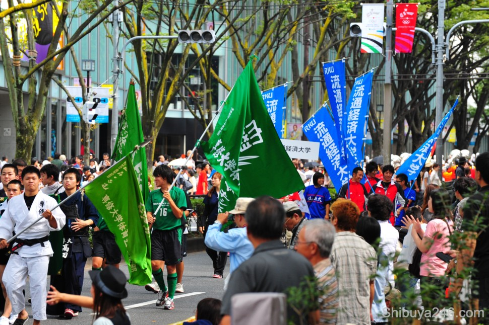 Plenty of flags and uniforms showing the University groups