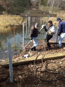 Madison volunteers build boardwalk structure at Hammonasset