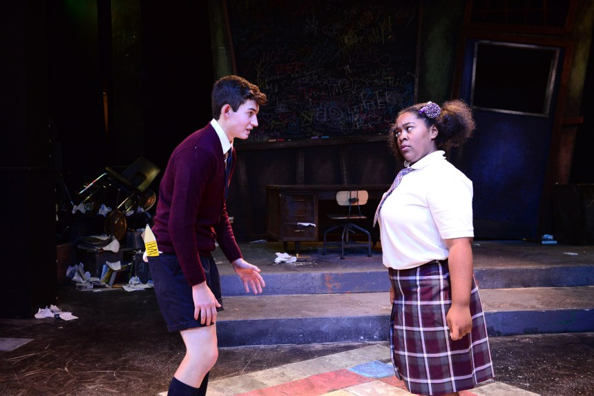 """(left to right) Justin Burns and Jauhara Sanders in The Hypocrites' THE 4TH GRADERS PRESENT AN UNNAMED LOVE-SUICIDE by Sean Graney, co-directed by Joel Ewing and Mechelle Moe, a collaboration with Senn Arts Magnet High School's """"The Yard."""" Photo by Evan Hanover."""