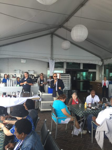 Commodore Greg Miarecki addressing the participants and volunteers at the luncheon on the Chicago Yacht Club terrace.