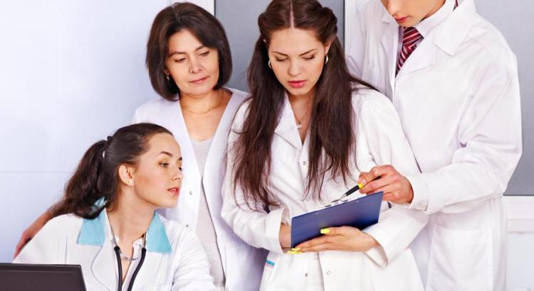 group-of-medical-professionals-reviewing-folder