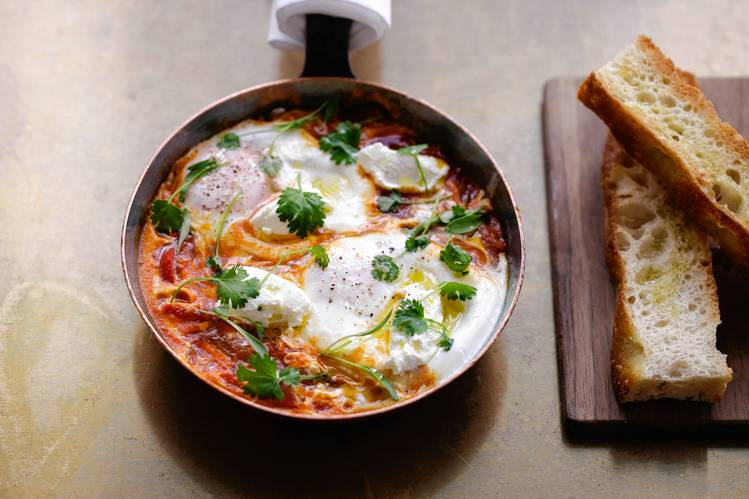 Shakshuka (braised eggs in tomato sauce with smoked labneh) at Nopi