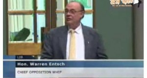 Australian-MP-Hon.-Warren-Entsch-presenting-the-Sikh-Genocide-petition-in-the-Parliament-300x194