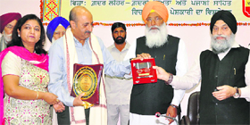 Families of martyrs being honoured at a seminar in Patiala