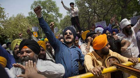 Sikh protestors shout slogans near a police barricade during a protest against Congress leader Capt Amarinder Singh for his recent remarks on 1984 anti-Sikh riots.