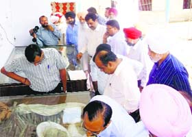 The team of the Archaeological Survey of India looks at the remains of martyrs at Kalianwala Khuh in Ajnala on Saturday
