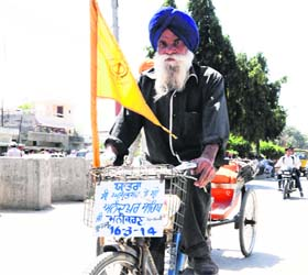 Paramjit Singh travels on his bicycle in Amritsar.