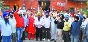 Members of the Sikh Katle-Aam Peerat Welfare Society protest against AAP candidate HS Phoolka in Ludhiana.