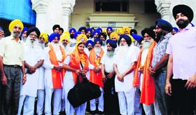Sikh pilgrims before (above) and after leaving for Pakistan in Amritsar on Saturday.
