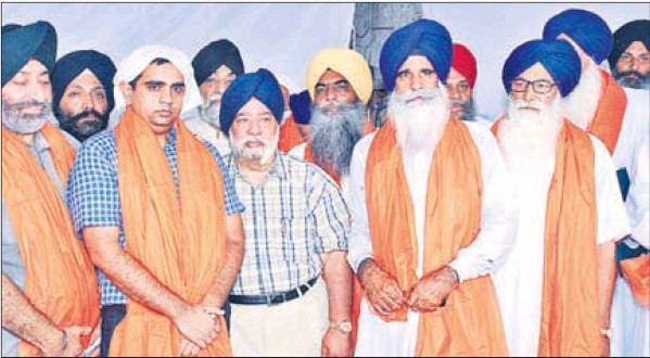 Members of the newly-elected executive body of the Haryana Sikh Gurdwara Management Committee (ad hoc) at Dera Baba Charan Singh Kar Sewa in Kurukshetra
