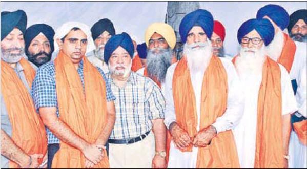 Members of the newly-elected executive body of the Haryana Sikh Gurdwara Management Committee (ad hoc) at Dera Baba Charan Singh Kar Sewa in Kurukshetra