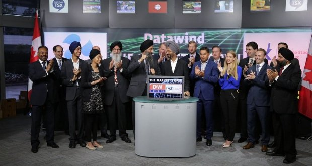 Seen in the picture, Suneet S Tuli, President and CEO and Raja S Tuli, Co-Chairman and CTO celebrating after opening the market at Toronto Stock Exchange