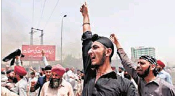 Sikhs, a minority community in Pakistan, protest the death of two traders in Peshawar on Wednesday.