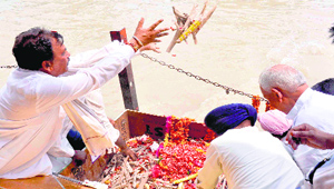 The remains of sepoys of 1857 uprising that were dug out from a well in Ajnala, Amritsar, being immersed in the Ganga at Haridwar